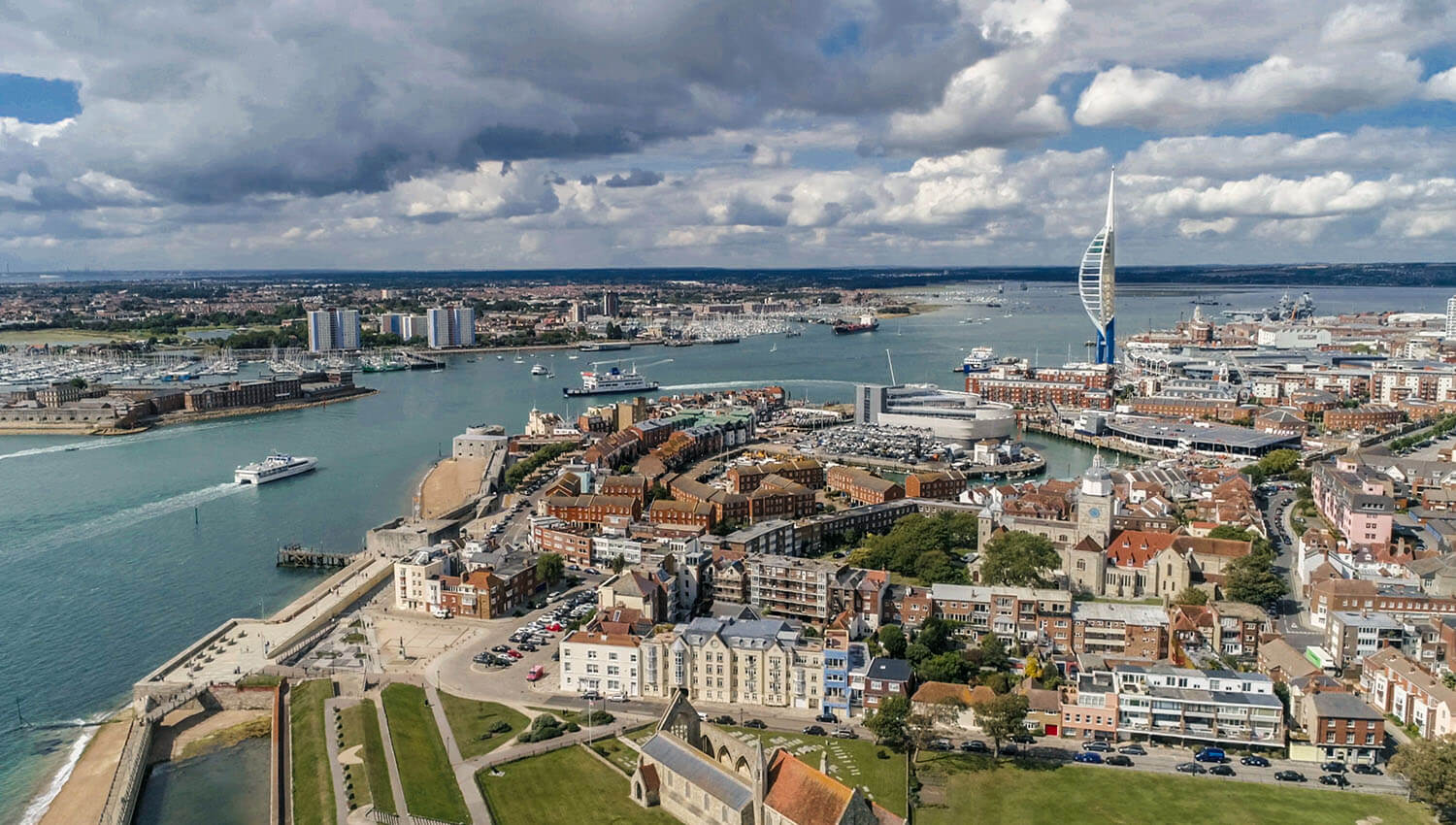 portsmouth city dock and landscape with cloudy sky boats on water